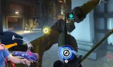This guy is a better Hanzo player than you… using a bow and a dance mat
