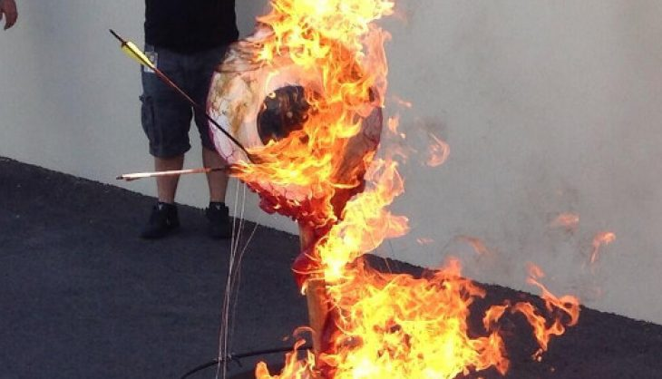 Neversoft's Eye mascot goes up in flames. Literally.